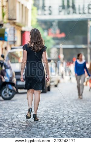 Pigalle, France- June 30, 2013:beautiful Woman Well Dressed Walk In A Cobbled Street Typical Of Pari