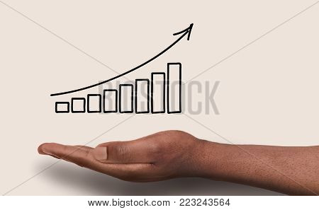 Conceptual business success background. African-american male hand over white backdrop with growth graph. Revenue, financial well-being and achievenment concept, copy space