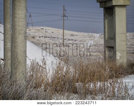 Concrete pillars of the railway bridge. Bridge. Grunge landscape