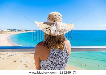 Woman standing at viewpoint over, Albufeira beach on the Algarve, Portugal