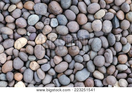 Stone pebbles texture or stone pebbles background. stone pebbles for interior exterior decoration design business and industrial construction concept design. Stone pebbles motifs that occurs natural.