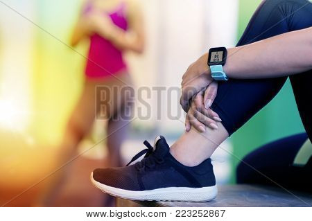 sport, fitness, technology, lifestyle and people concept - close up of woman with heart rate tracker in gym