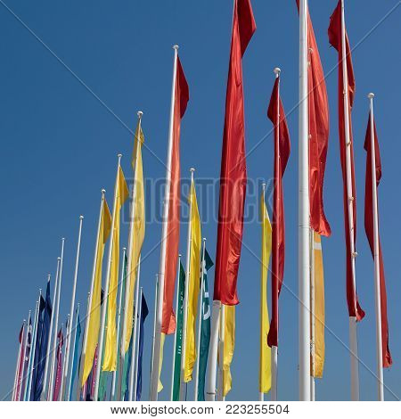 Colorful Groups of Flags against Blue Sky.