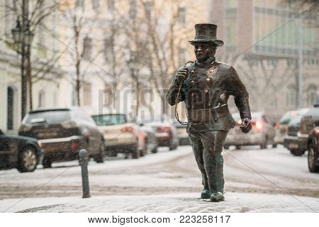 Tallinn, Estonia - December 3, 2016: Bronze Statue Of A Lucky Happy Chimney Sweep With Some Bronze Footsteps Behind Him.