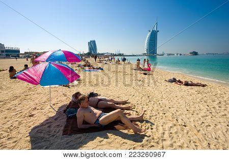 DUBAI, UNITED ARAB EMIRATES - JAN 02, 2018: Public beach of Dubai near the Burj Al Arab hotel.
