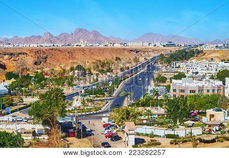 SHARM EL SHEIKH, EGYPT - DECEMBER 15, 2017: Aerial view of the El Salam road in Sharm El Maya district, stretching among the rocky cliffs, on December 15 in Sharm El Sheikh.