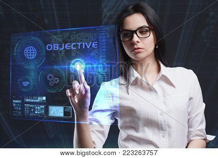 The concept of business, technology, the Internet and the network. A young entrepreneur working on a virtual screen of the future and sees the inscription: Objective
