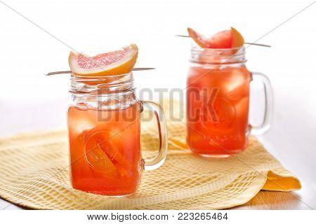 Invigorating citrus cocktails standing on a beige napkin