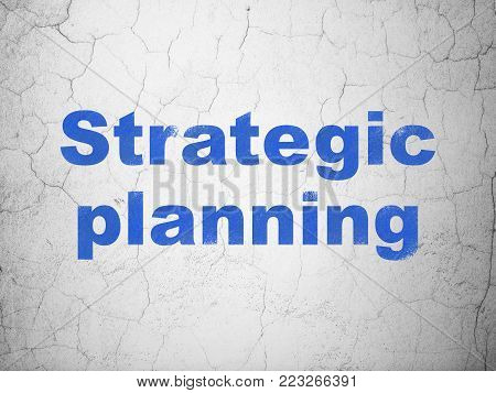 Finance concept: Blue Strategic Planning on textured concrete wall background