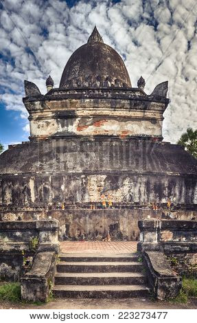 Beautiful view of stupa in Wat Visounnarath. Luang Prabang. Laos. Vertical Panorama