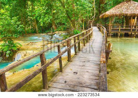 Bridge on the way to Tat Sae Waterfalls. Beautiful landscape. Luang Prabang. Laos.