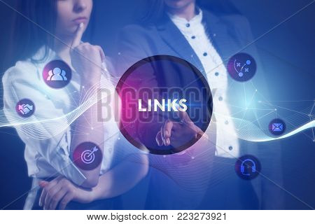 The concept of business, technology, the Internet and the network. A team of business women working on the virtual screen of the future and see the inscription: Links