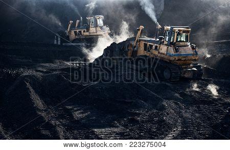 Excavators are working, dirty job, industrial, smoke