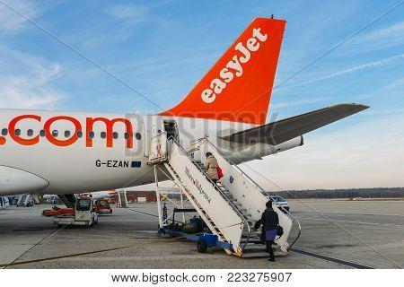 Milan Malpensa, Italy - November 21st, 2017: Passengers board an Easyjet Airbus A320 airplanes at Milan Malpensa airport, servicing short-haul flights in Europe