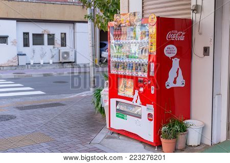 Eco Coca-Cola red vending machines sell beverage products with cute polar bear mascot found around Osaka Japan December 2017.