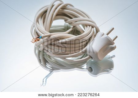 electric cord with plug on white background. wire for connecting the electronics to the network