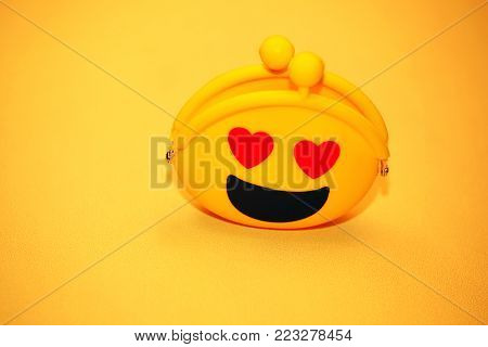 Yellow Smile Money Purse heart eyes yellow background