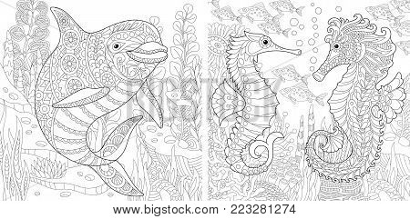 Coloring Page. Adult Coloring Book. Underwater Ocean. Dolphin among marine seaweed. Sea horse, shoal of tropical fishes. Antistress freehand sketch collection with doodle and zentangle elements.