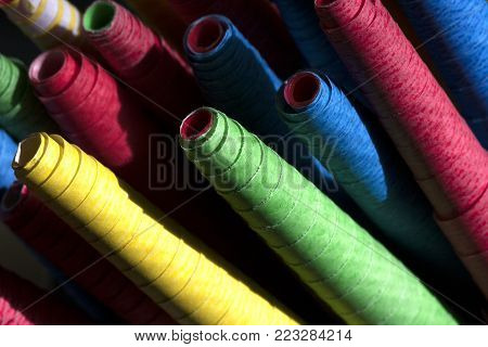 Colorful paper flings form a celebration of rainbow of colors - red, yellow, blue and green