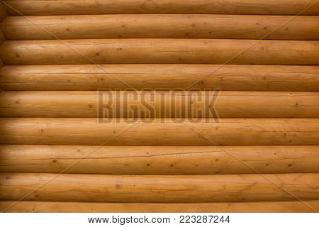Natural background pattern of a log wall close up
