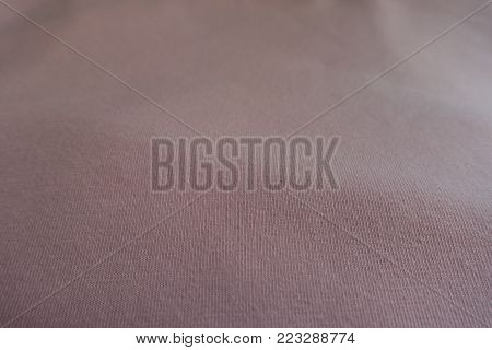 Texture of simple unprinted light pink fabric