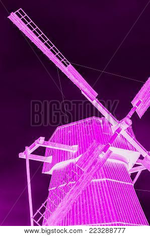 windmill village windmill with large blades unusual neon purple for entertainment and fun
