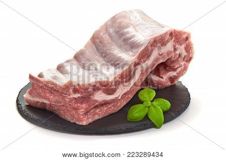 Raw Pork Pieces On Stone Plate, Close-up, Isolated On White Background.