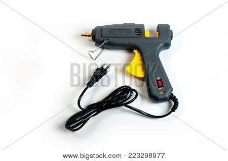 Glue gun electric, new on a white background