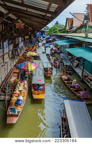 RATCHABURI, THAILAND - AUGUST 14: This is Damnoen Saduak floating market. It is a famous place where tourists come to try Thai food buy souvenirs and experience the culture on August 14, 2017 in Ratchaburi