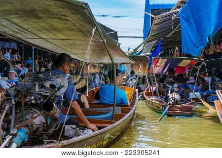 RATCHABURI, THAILAND - AUGUST 14: Boats in Damnoen Saduak floating market which is a famous floating market and is very popular amongst tourists on August 14, 2017 in Ratchaburi