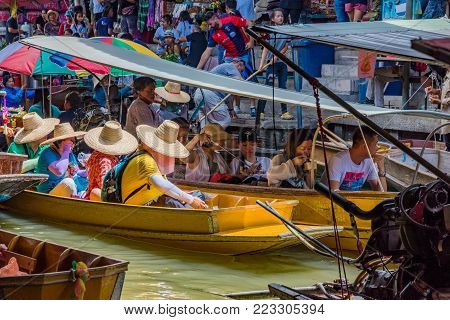RATCHABURI, THAILAND - AUGUST 14: This is busy scene in Damnoen Saduak floating market which is a popular landmark for tourists on August 14, 2017 in Ratchaburi