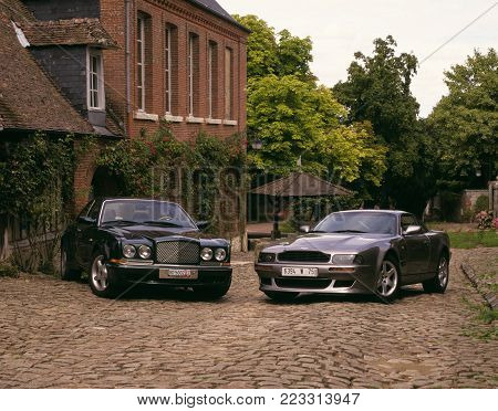 GERBERY, PICARDIE, FRANCE: BENTLEY TURBO AND ASTON MARTIN V8 VANTAGE ON COBBLED STREET, 25TH JULY, 2003, GERBEROY, PICARDY, FRANCE