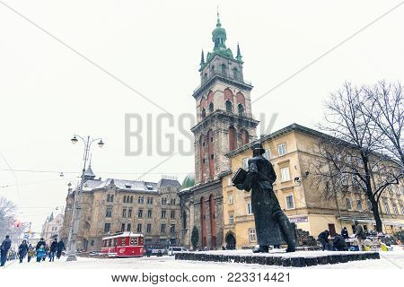 Lviv, Ukraine - January 21, 2011: Monument To Ivan Fedorov Forefront, Stauropegial Church Of The Ass