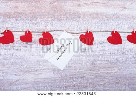 Red hearts on wooden background.Valentines day greeting card.Top view with copy space.