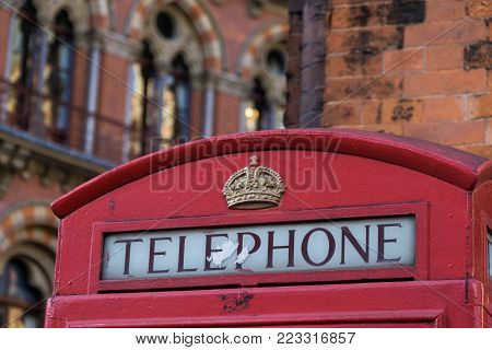 Red Telephone Box in London in front of St Pancras Hotel