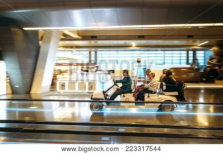 Doha city, Qatar - December 18, 2017: Airport electric car carries the passengers. Interior of the New opened five stars Hamad International Airport  in Doha, Qatar
