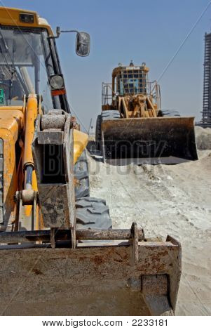 Excavator Tractor And A Wheel Loader