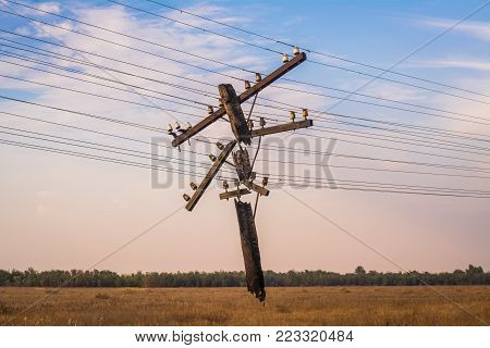 Destroyed power line. Abandoned power line. Power line. Old power line
