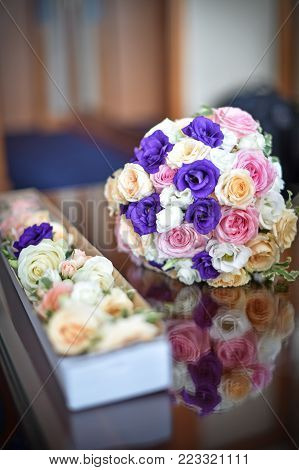 beautiful bouquet of rose flowers, on table .wedding bouquet  from red roses.elegant wedding bouquet on table at restaurant .Wedding decoration on table. Floral arrangements and decoration