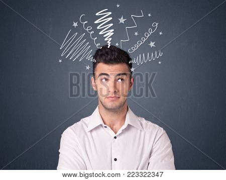 Young casual businessman with white scribbles around his head
