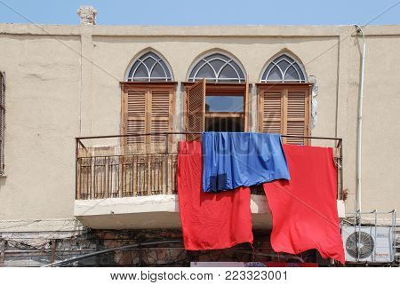 TEL AVIV, ISRAEL - AUGUST 18, 2010: Horizontal picture of colorful sheets getting dry in Jaffa in Tel Aviv, Israel
