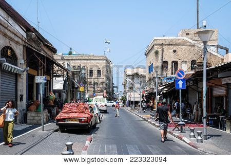 TEL AVIV, ISRAEL - AUGUST 18, 2010: Wide angle picture of parked cars and old buildings in Tel Aviv, Israel