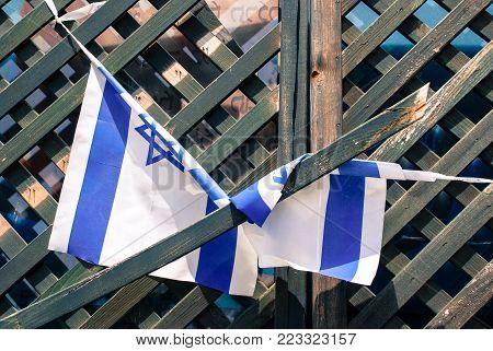 Israeli flags tied on wooden door in Tel Aviv, Israel