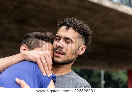 Gay Couple Embracing