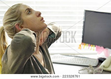 Tired Neck. Young office worker Woman Suffering From Neck Pain. Female Feeling Tired, Exhausted, Stressed. Girl Massaging Painful Neck With Hands. Body And Health Care Concept.