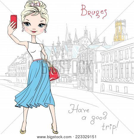 Cute fashionable girl makes selfie, scenic city view of Bruges canal with beautiful medieval houses on the background, Belgium.