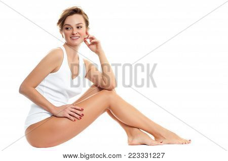 Beautiful woman in white lingerie. Long woman legs with smooth skin after depilation.