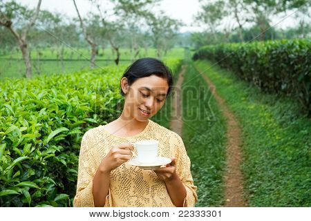 Ethic Young Woman Relaxing At Tea Plantation