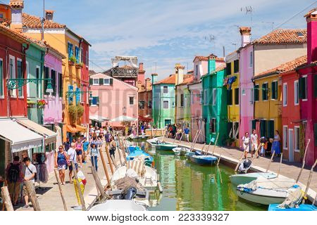 BURANO,ITALY - JULY 27,2017 : Brightly painted houses and canals on the island of Burano near the city of Venice