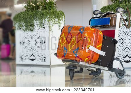 Airport luggage Trolley with suitcases Travel concept.